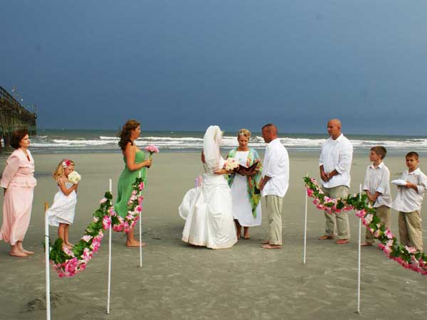 beach-wedding-beside-pier-storm