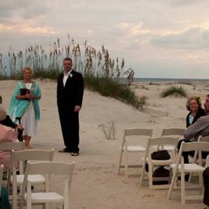 groom-on-beach-waiting-for-bride